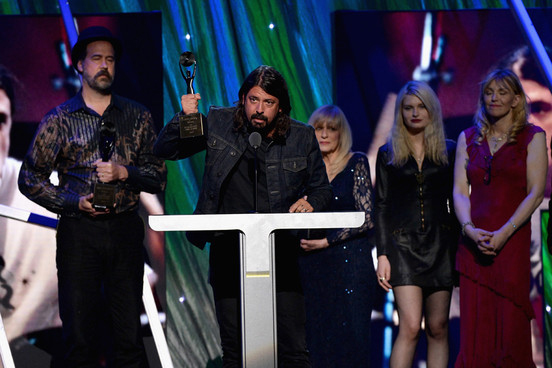 Nirvana Dave Grohl holding up trophy